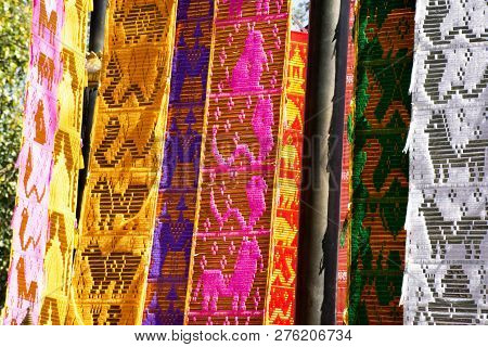 Thai People And Foreign Travelers Hanging Holy Flags Or Colorful Tung Flag Of Lanna Or Northern Of T