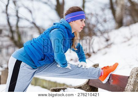 Outdoor Sport Exercises, Sporty Outfit Ideas. Woman Wearing Warm Sportswear Training Exercising Stre