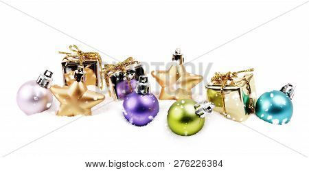 Pastel Color Small Christmas Decoration Items In Snow Isolated On White