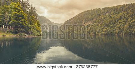 View Into Beautiful Mountain Lake Pass In Alps. Calm Lake Water And Sunny Weather, Lake Reflection