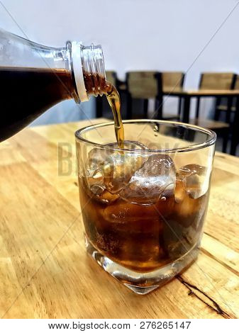 Cola In Glass Ice, Pouring Cola From Glass Bottles Drinks To A Glass With Ice Cubes, Cola In Glass I
