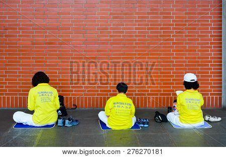 Taipei, Taiwan - May 7, 2017 : Member Of Falun Gong Wear A Yellow Shirt With Text