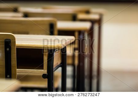 Lecture Room Or School Empty Classroom With Desks Chair Iron Wood For Studying Lessons In High Schoo
