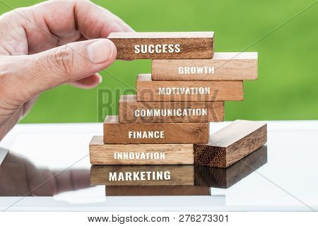 Strategy Planning Risk In Business Concept : Businessman Placing Wooden Blocks With Letter E.g Marke