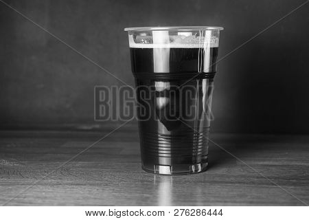 Vintage Black And White Photography. A Glass Of Cheap Craft Beer In Pub Or Bar
