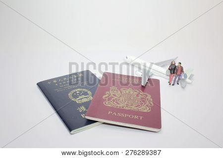 A Mini Figure With Pasport On Board