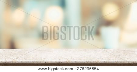 Empty Glossy Marble Table And Blurred Soft Light Table In Restaurant With Bokeh Background. Product