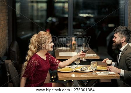 Couple In Love At The Restaurant. Proposal And Anniversary. Date Of Family Couple In Romantic Relati
