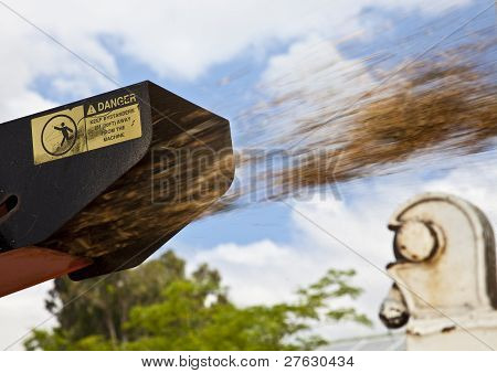 Tree shredder in action