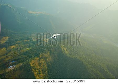 Ultralight Aircraft And Trees And Snowcapped Peak At Background In The Himalaya Mountains, Nepal