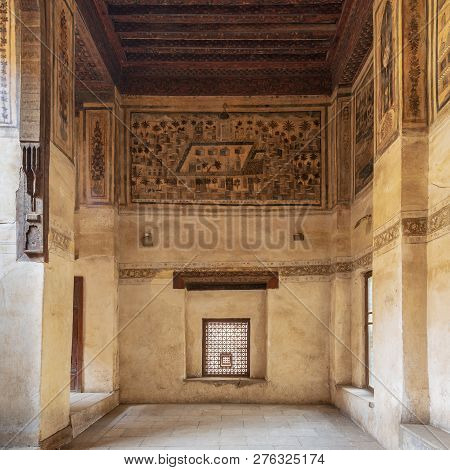 Cairo, Egypt - December 16 2018: Stone Wall With Wooden Window (mashrabiya) And Mural Depicting City