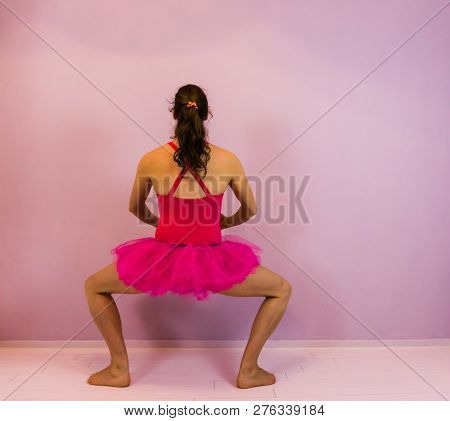 Ballerina Performing A Plie In A Pink Tutu, Classical Ballet Move, Young Transgender Girl In The Dan