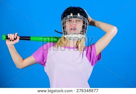 Woman in baseball sport. Baseball female player concept. Break sport stereotype. Woman enjoy play baseball game. Girl confident pretty blonde wear baseball helmet and hold bat on blue background. poster