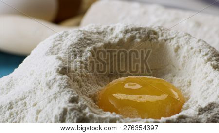 Yolk Falls Into the Flour in Slow motion, close up. Scene. Falling eggs into flour stock. Footage food. Egg dropping into flour, slow motion. Food Blog, Flour Products. Bakery products. Preparation of the dough poster