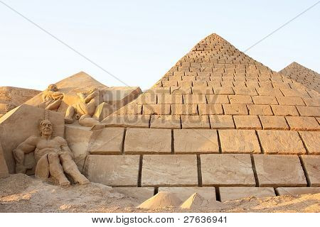 Pyramids made from sand against a blue sky