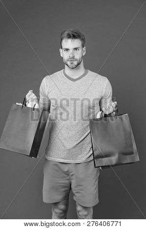 Man Bearded Face Holds Shopping Bags. Guy Bought Lot Sporty Clothes And Accessories. Man Shopping On
