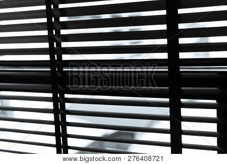 Opened Venetian Plastic Blinds In Black And White. Plastic Window With Blinds. Interior Design Of Li