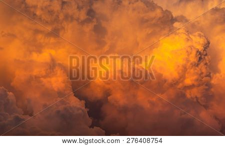 Dramatic Orange Sky And Clouds Abstract Background. Top View Of Orange Clouds. Warm Weather Backgrou