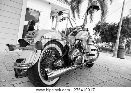 George Town, Cayman Islands - February 06, 2016: Harley Davidson Motorcycle Parked At House. Motorcy