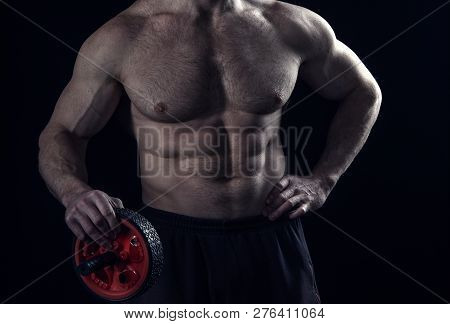 Bodybuilder Man Or Sexy Muscular Guy With Athlete Body, Torso And Chest Training In Gym, Holds Red S