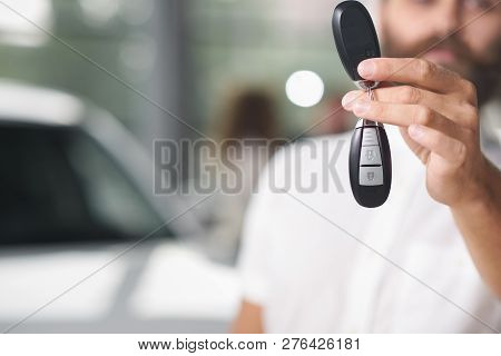 Car Keys Close Up. Hand Of Man Holding Keys. Customer Of Car Dealership Buying New Expensive Car. Co