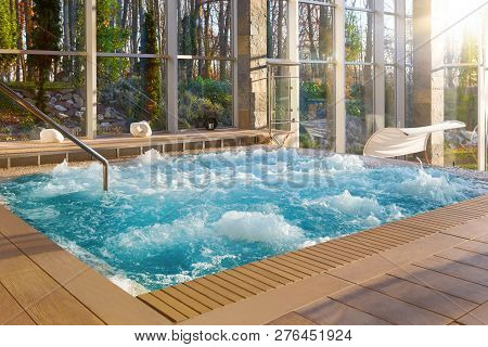 Luxurious Hot Tub Spa In Boutique Hotel With Big Glass Windows With Nature View.