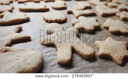 closeup of homemade cookies in different shapes with intentional blur