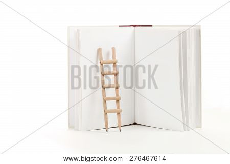 Pencil Ladder On Blank Book Isolated, Education Concept