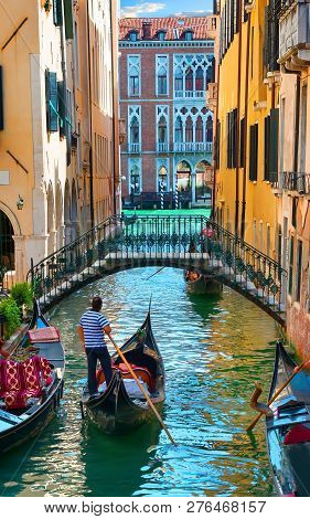 Narrow Street Of Venice On Waters Of Grand Canal