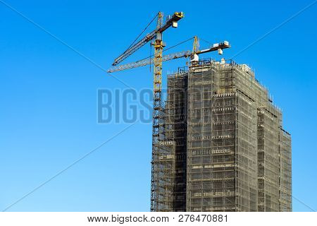 Tower Crane Scaffolding Construction High-rise Building Blue Sky