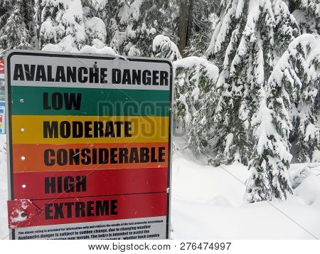 Vancouver, Canada - December 28, 2018: The avalanche warning sign on Cypress Mountain in Vancouver, British Columbia, Canada displays extreme level avalanche danger.  Avalanches are a serious threat.