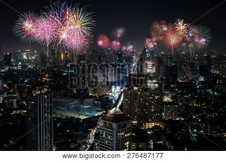Cityscape Of Bangkok Metropolis With Fire Work Celebration