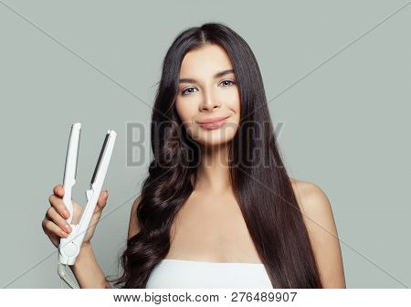 Happy Woman With Straight Hair And Curly Hair Using Hair Straightener. Cute Girl Straightening Healt
