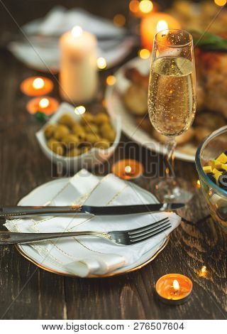 Festive Champagne Glass And Romantic Candlelit Dinner, Background For Invitation