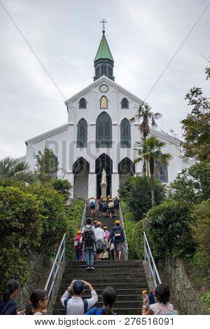 Nagasaki, Japan - October 26, 2018: Tourists walking on the stairs to the old christian Oura Church