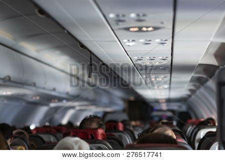 Passenger Seat, Interior Of Airplane With Passengers Sitting On Seats. Travel Concept,vintage Color,