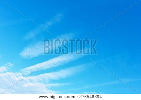 Angel wing - Blue sky with phenomenal white clouds. Background with space for your own trxt
