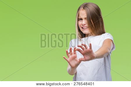 Young beautiful girl over isolated background disgusted expression, displeased and fearful doing disgust face because aversion reaction. With hands raised. Annoying concept.