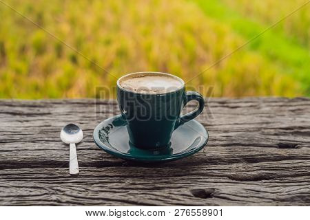 A Cup Of Coffee On The Background Of An Old Wooden Table