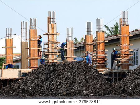 Soil Mound, Clay Wet Black And Construction Site, Construction Workers, People Labor Are Working On