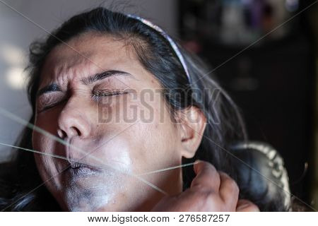 Painful Plucking And Removal Of Upper Lip Hairs Of A Lady With Threading. Epilation Cosmetic Procedu