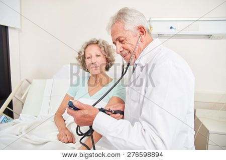 Doctor makes blood pressure measurement in a patient to control high blood pressure