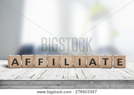 Affiliate Marketing Sign On A Wooden Desk With A Blurry Office Environment In The Background