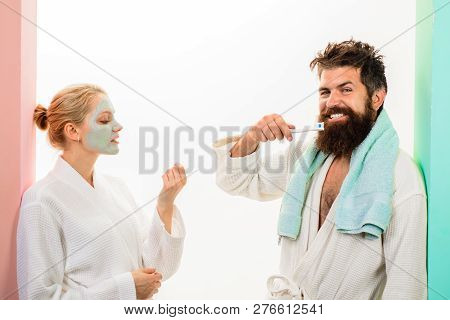 Couple. Relationship. Bearded Man With Toothbrush. Cosmetic Facial Mask. Morning Treatments. Health.