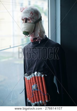 Stop terror.  bomber in gas mask dummy casualty in head. Terrorist wear fake suicide bombers belt. Suicide attacker. War soldier or victim. War or terrorism attack. Countering terrorism. poster