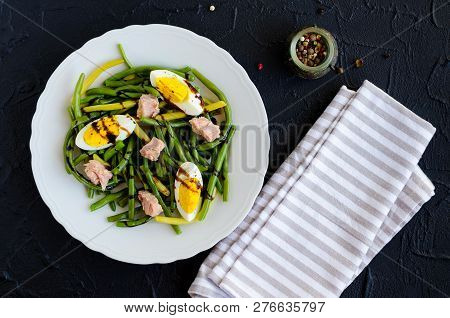 Fresh Summer Warm Salad With Cooked Green Beans, Tuna, Boiled Eggs And Sauce Balsamico Glassa In Whi