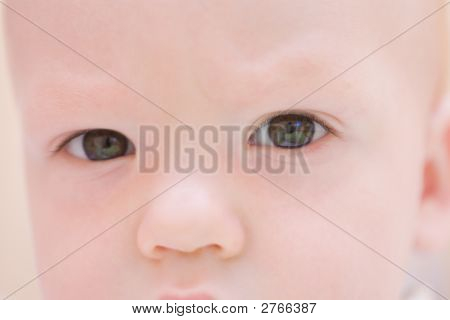 Serious Baby Face. Eyes Close-up