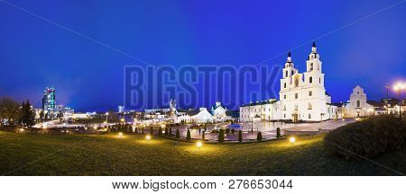 Minsk, Belarus. Night Panorama Of Illuminated Cathedral Of Holy Spirit In Minsk. Famous And Main Ort