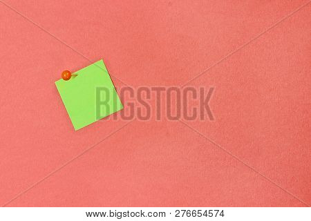 Blank Green Note Pad Paper Over Coral Color Background With Free Space For Text. Image Shot From Abo