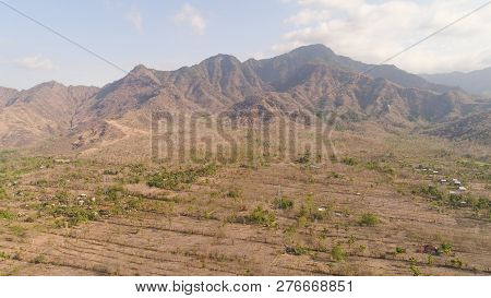 Aerial View Agricultural Land And Mountains In Countryside. Mountain Range With High Cliffs Mountain